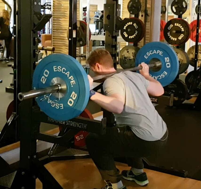 St Albans Personal Trainer performing barbell squats